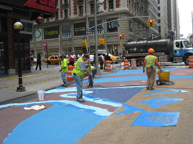 Crews paint the ground in preparation of a new pedestrian plaza in New York City.